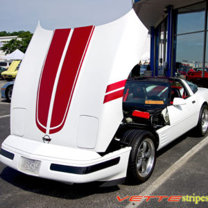White C4 Corvette with metallic red CE stripe