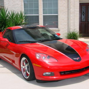 Red C6 Corvette with black and silver ME stripes