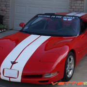 Red C5 Corvette convertible with white full body racing stripe style 3