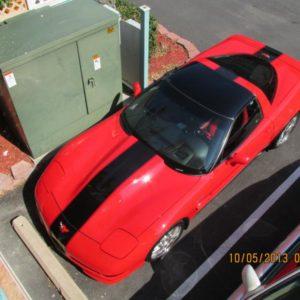 Torch red C5 Corvette with black Grand Sport stripe