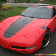 Torch Red C5 Corvette coupe with metallic black and dark charcoal ME stripe
