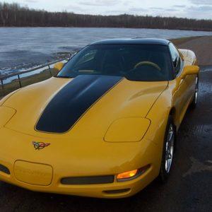 Yellow C5 Corvette with black classic stripes