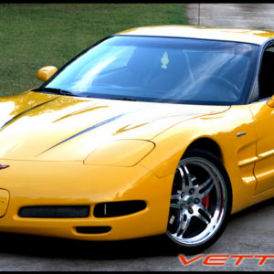Yellow C5 Corvette with black hood spear stripe