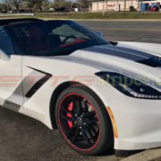 White C7 Corvette Stingray with matte silver GM full body racing stripes